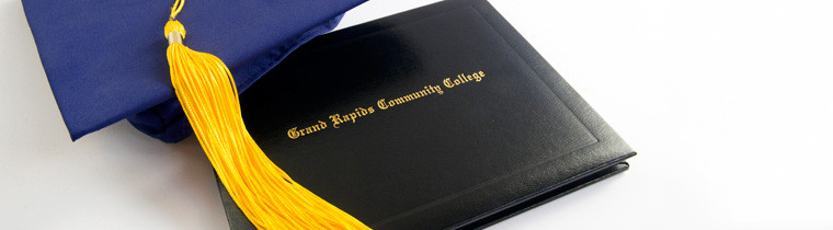 GRCC diploma cover and graduation cap