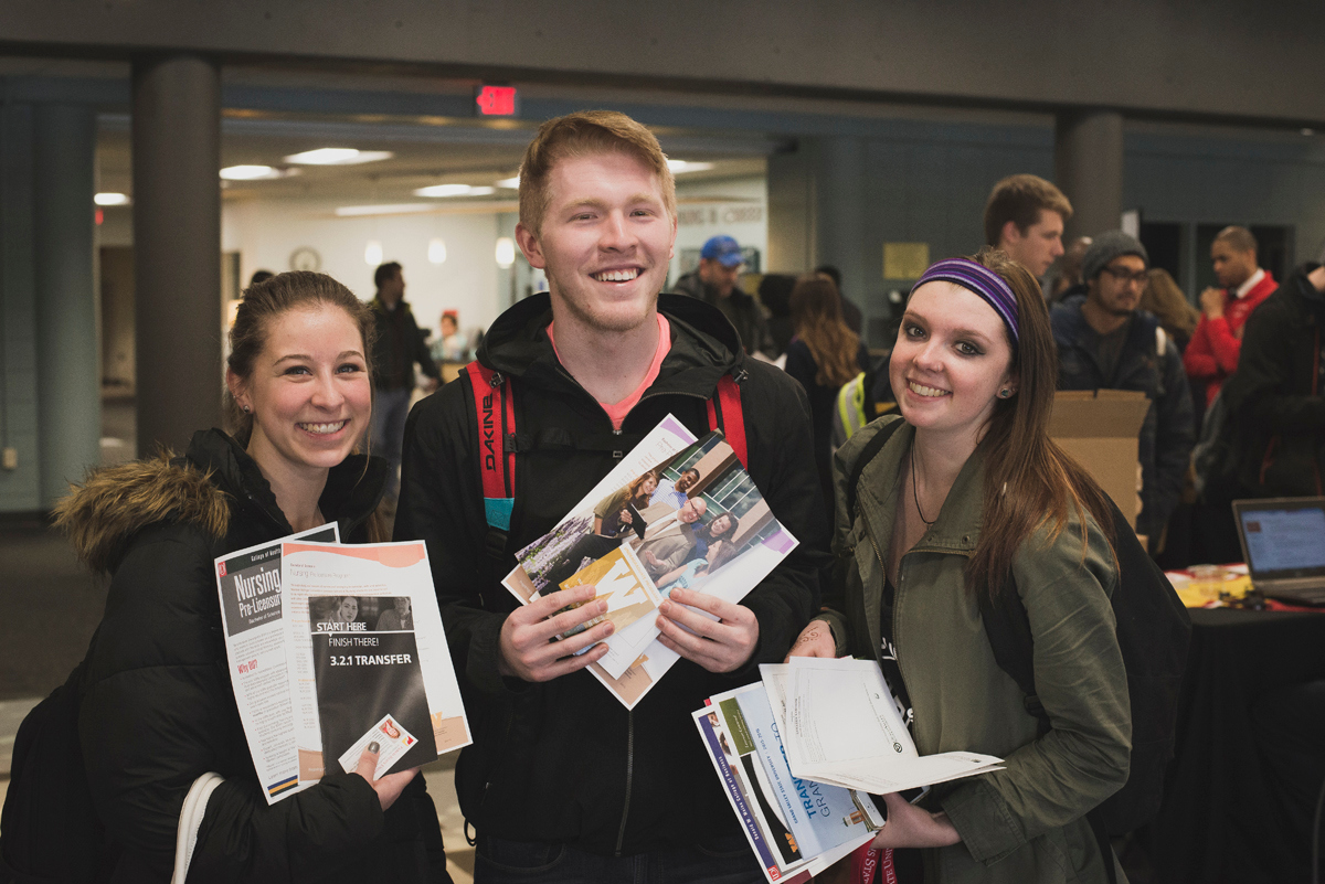 Three GRCC students holding transfer materials